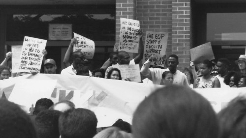 1201x782-BROTHERS-OF-THE-BLACK-LIST-Students-protest-in-front-of-the-colleges-administration-building-in-Fall-1992-Image-by-Bruce-Endries-2-1160x652
